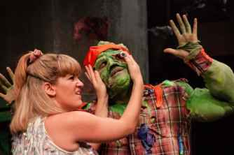 THE-TOXIC-AVENGER-THE-MUSICAL-8-Emma-Salvo-as-Sarah-Mark-Anderson-as-Toxie-Photo-Irina-Chira-min