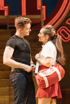 Dan_Partridge_as_Danny_and_Martha_Kirby_as_Sandy_in_the_UK_and_Ireland_tour_of_GREASE,_credit_Manuel_Harlan_1000_1499